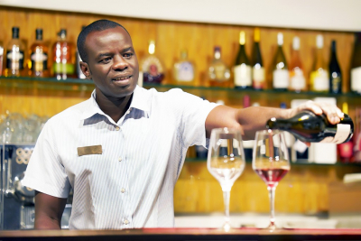 man on his bar business smiling